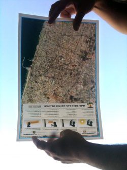The streets of Tel Aviv showing through the two sided dislocative tourism map of Gaza